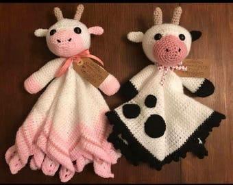 Handmade crochet cow comfort blanket