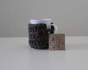 Cup with crocheted wool made toilet seats
