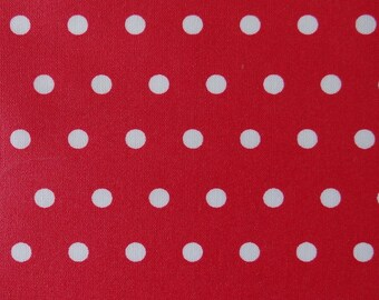 Red laminated cotton fabric with white polka dots