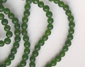 ROW OF GREEN 6 MM QINGHAI JADE BEADS