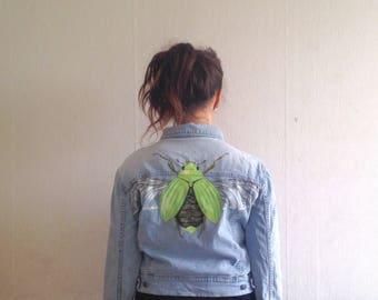 Vintage denim jacket with hand painted green beetle image.