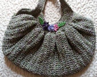 crocheted in green thread and shiny lurex handbag