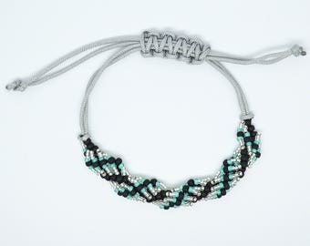 Adjustable Friendship bracelet hand made with aqua silver and black Myuki seed beads set in a twist on silver colour macrame para cord
