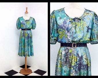green vintage dress with boho floral pattern