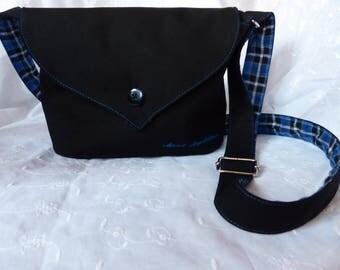 Black shoulder bag with blue Scottish tartan lining