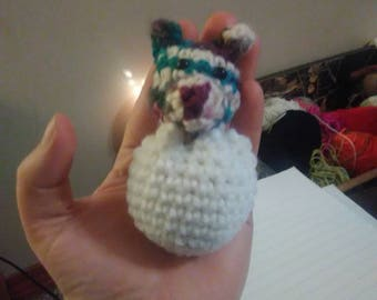 Amigurumi dragon hatching out of an egg