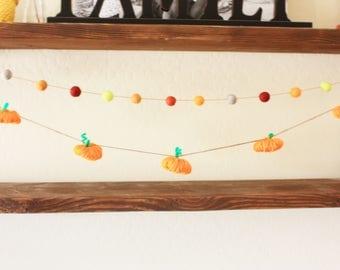 Handmade yarn pumpkins and felt ball garland