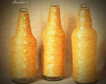 3 * hand crafted twine wrapped bottles