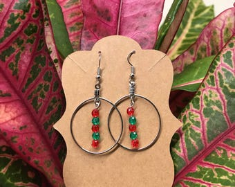 Silver hoop earring with red & green beads