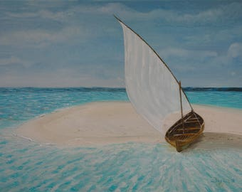 Sailing boat on a lonelv beach