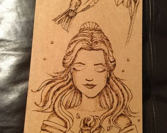 Wood burning girl and a flower