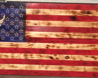 Wooden American flags.