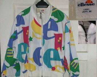 ELLESSE ITALIA Vintage 90s Big Logo Spell Out Windbreaker Jacket. Medium size (Ladies)