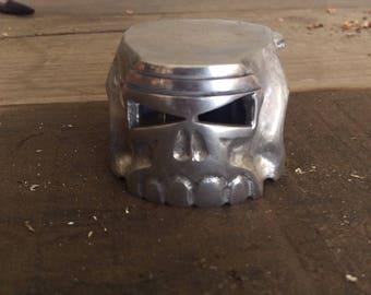 Piston skull carving