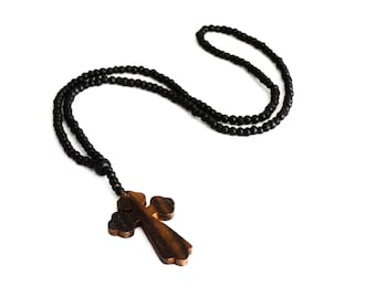 Black necklace with wooden beads and a cross