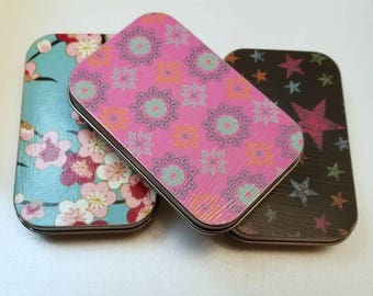 Large tin trio . . . Lovely flowers stars and patterns. Great for purse organizing.