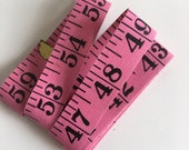 Vintage Dean Tape Measure - pink coated fabric - excellent vintage condition