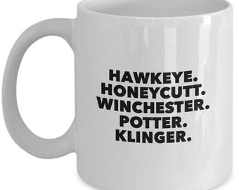 M*A*S*H tv show character list coffee mug / Hawkeye Pierce / BJ Honeycutt / Charles Winchester / Sherman Potter / Max Klinger / 70s 80s cup