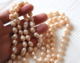 Vintage knotted peach baroque pearl necklace