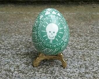 Green Happy Skeleton guinea egg pysanka
