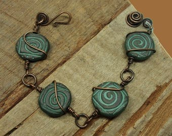 One of a Kind Handmade Bracelet of Wire Wrapped Round Chocolate Stoneware Beads Impressed with Infinity Symbols, Hand Formed Closure