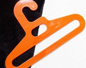 European orange plastic clothes hanger / German 1960s 70s mod pop acrylic hanger/ Modernist clothing storage rack