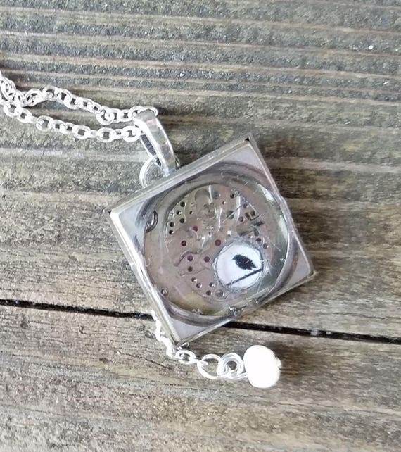 Blackbird - upcycled metal and resin pendant with old watch parts