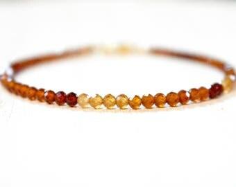 shaded hessonite garnet bracelet. faceted hessonite golden garnet with red. golden ombre pattern bracelet. hessonite garnet bracelet