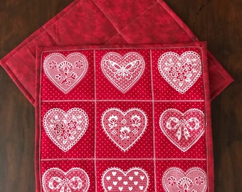 """Two Red and white mug rugs. Heart mug rugs, hearts with flowers, bows, and butterflies, polka dot prints coasters, 8.5"""" square"""