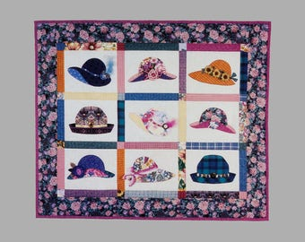 Hattitudes quilted wall hanging Around the Block Quilt designs #115 UNCUT Designed by Judith Hughes Marte 4 different hat shapes 38 x 46 ins