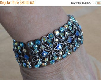 On sale Pretty Vintage Blue Aurora Borealis Rhinestone, Silver tone Filigree Stretch Bracelet (AP14)