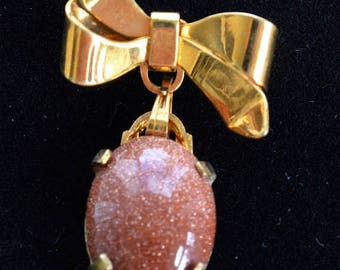 ON SALE Goldstone Bow Pin, Gold tone, Vintage, Dangle (H11)