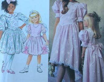 1990s Girls Dress Pattern with full skirt gathered to bodice. Simplicity 7075 Girls Formal Dress Pattern in Two Lengths  Girls size 7-14
