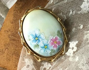 Charming Hand Painted Floral Cameo Brooch Pendant Unsigned 1960's 1970's Gold Tone Frame Blue Pink Flowers White Detail LIght Green Ornate