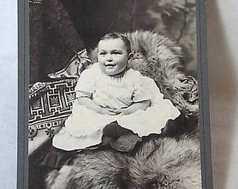Antique Cabinet Card Photo of Chubby Baby on Fur Rug, Slightly Diabolical