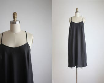 minimalist black slip dress