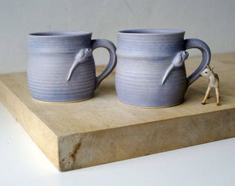 Two stoneware pottery coffee mugs - glazed in lavender blue with tiny mouse