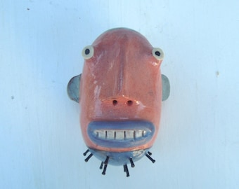 Pink man w/nail beard wall sculpture small rd. head