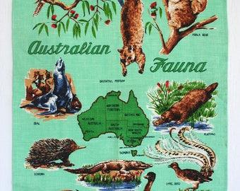 Linen souvenir towel from Australia. Tea towel, kitchen towel, Australian wildlife, coala, platypus, cangaroo, emu, echidna, sea foam