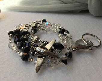 Silver Airplane ID Badge Lanyard with black shimmer pearls