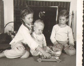Three Little Children Play with Toy Car in front of fireplace Vintage Photo