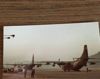 Military transport planes maybe c 130s? 5 x 3