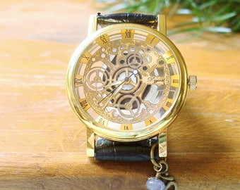 Steampunk Wrist Watch - Golden Deluxe -  Looks Like Mechanical Wrist Watch, Iolite and Ohm charm, Skeleton Dial, See Thru, Mens Womens C-397