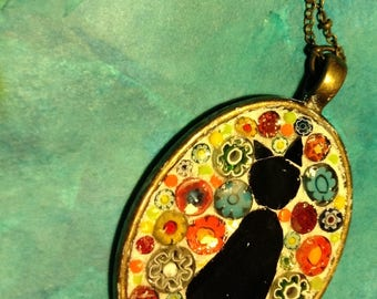 Mosaic left facing black cat oval antique gold pendant with millefiori background