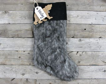 Fur Christmas Stocking with black cuff and bear ornament