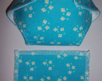 Baby Doll Diaper/wipe - clusters of white star-like flowers, yellow centers on turquoise - adjustable for many dolls such as bitty baby