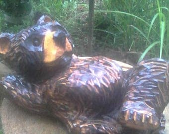 chainsaw carving bear lazy relaxing