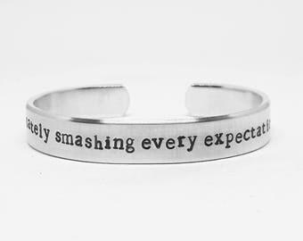Passionately smashing every expectation: Hand Stamped Aluminum Hamilton Musical quote cuff by fandomonium