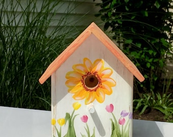 Small decorative rustic terracotta birdhouse