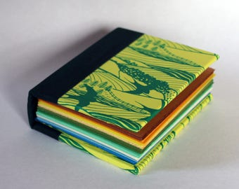 Tiny rainbow hardback notebook in yellow and green 'Hills and Dales' design